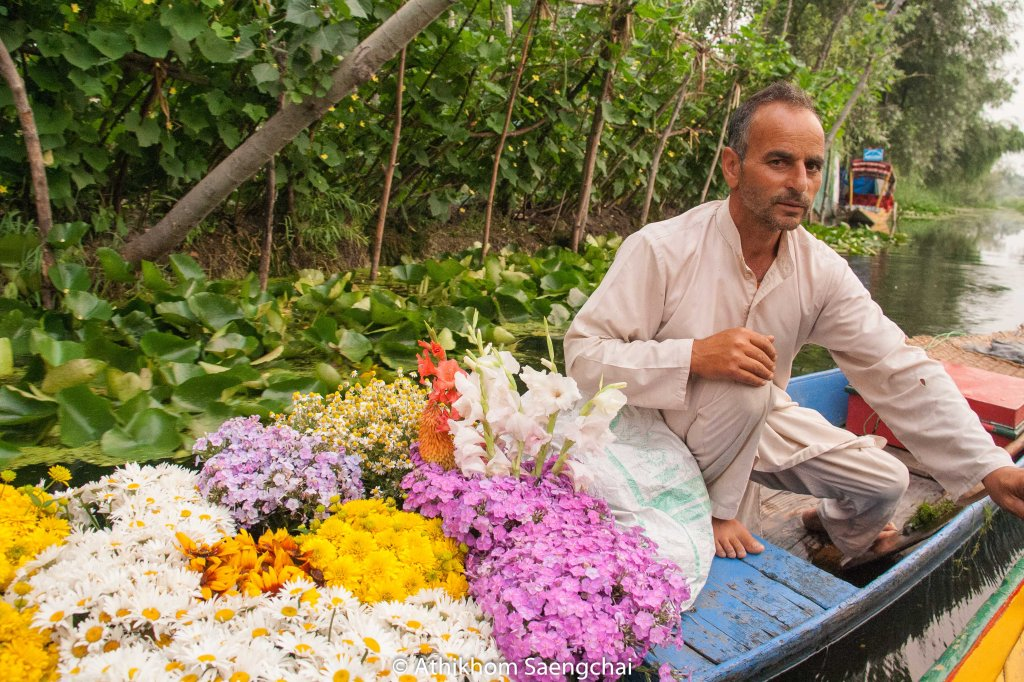 Bashira Ahmed Akhoon on his boat loaded with colorful flowers